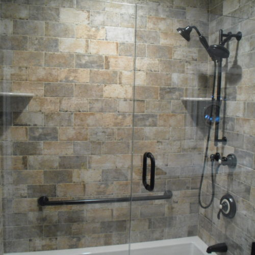 Bath Remodel with Brick Tile Surround and Shower Enclosure
